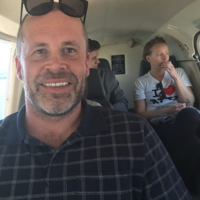 Man, smiling while on a small plane after taking Dr. Shulman's Non Flyer course.