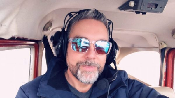 Man on a practice flight after taking a fear of flying course.