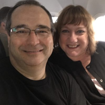 Man and woman, smiling, on a flight to Montreal after he took Dr. Ian Shulman's The Non Flyer course.